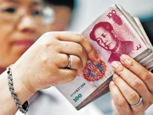 人民币兑美元中间价调贬84个基点 报6.4003