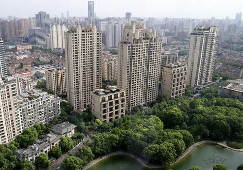 易纲:五大方面支持上海国际金融中心建设