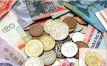 15日人民币对美元中间价下调34个基点