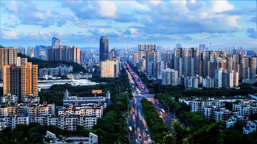 """谁是中国""""经济一哥"""":江苏、广东追逐大战40年"""