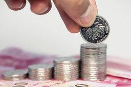 在岸人民币对美元汇率开盘拉升近百点