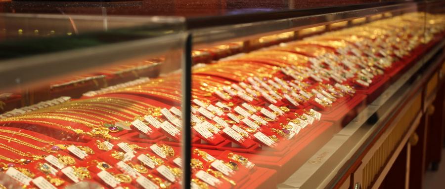 黄金价格大涨之后 门店消费冷清 实物回购火热
